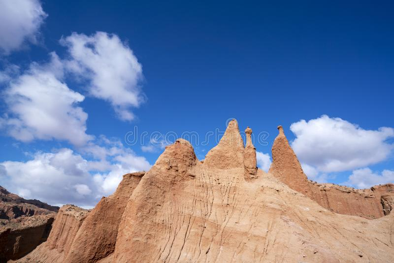 Blue sky white clouds and colorful Wensu Grand Canyon in Autumn royalty free stock images