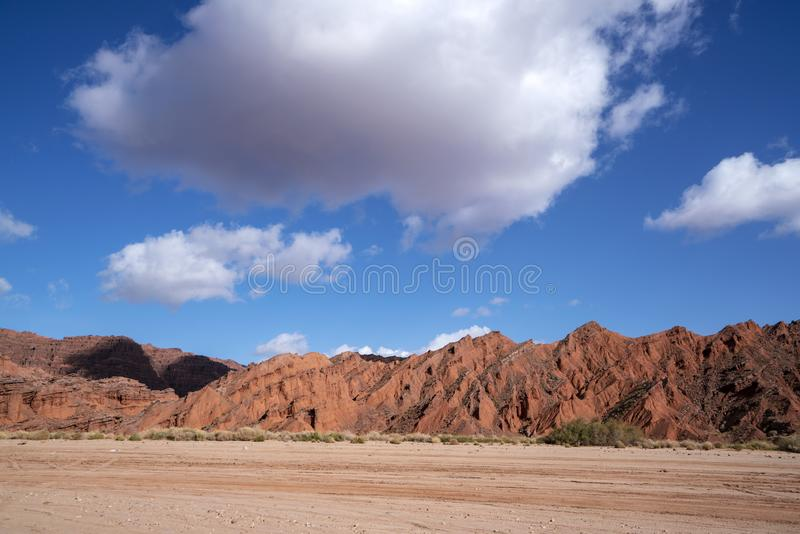 Blue sky white clouds and colorful Wensu Grand Canyon in Autumn royalty free stock photos