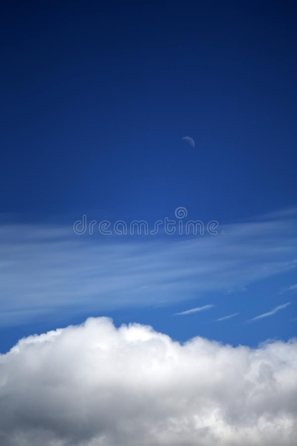 Blue sky and white clouds and the moon that appears during the day stock photos