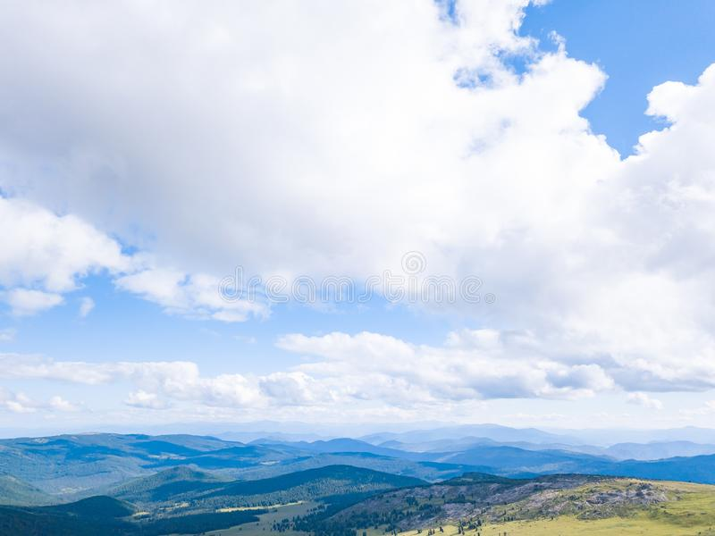 Blue sky with white clouds in mountains. In summer stock photo
