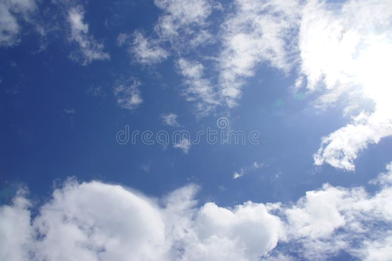 Blue sky, white clouds, natural beautiful, transparent, refreshing, see the sun shining. Background image royalty free stock photo
