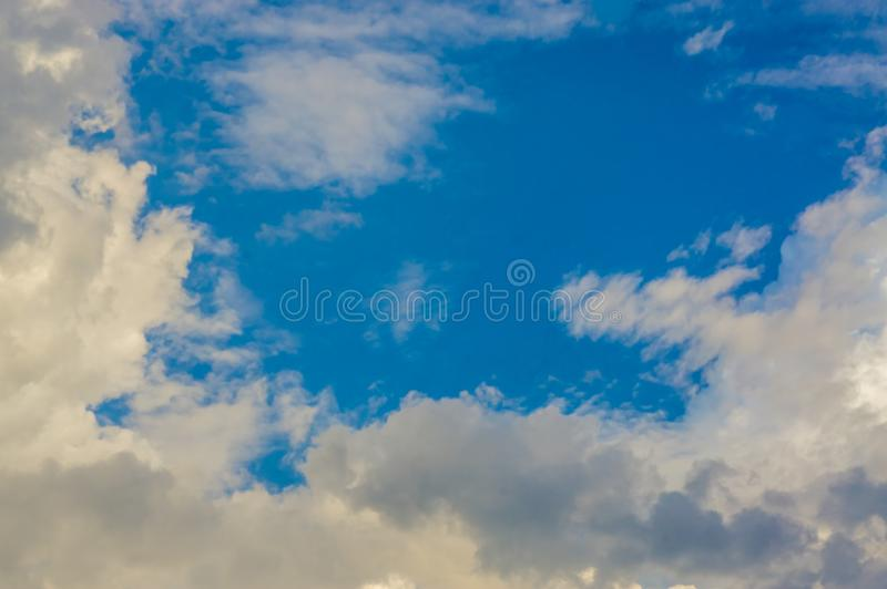 Blue sky with white clouds in natural form, weather bright in early morning of Southeast Asia.  royalty free stock photos