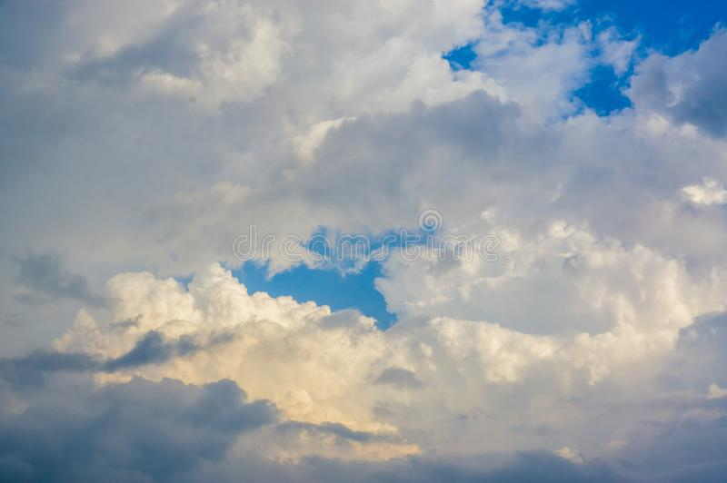 Blue sky with white clouds in natural form, weather bright in early morning of Southeast Asia.  stock photos