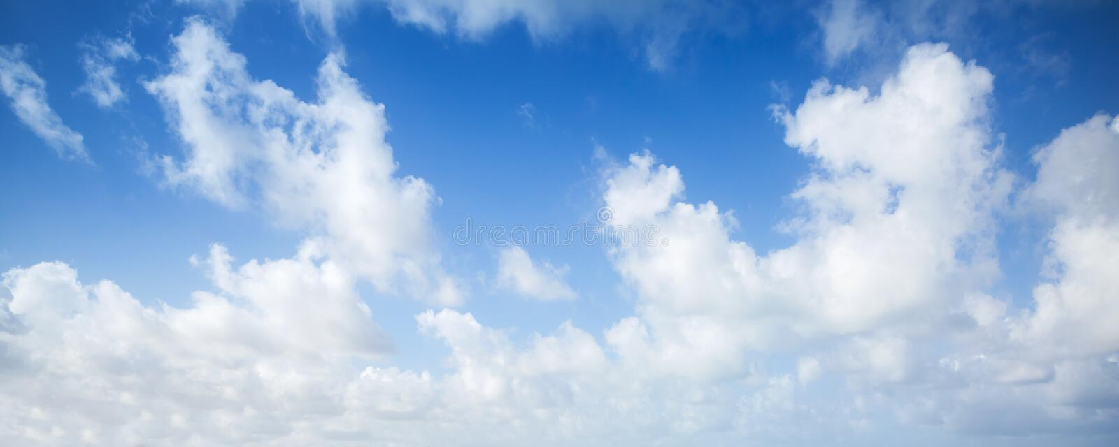 Blue sky and white clouds, panoramic background royalty free stock photos