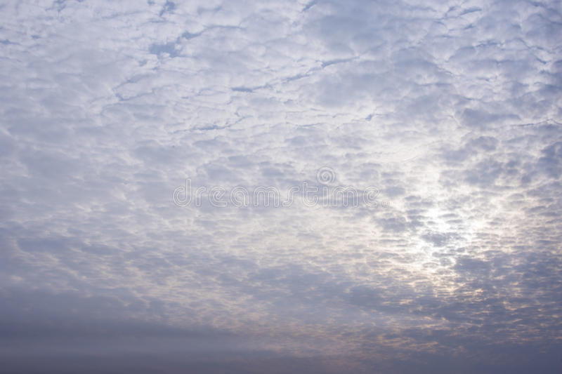 Blue sky and white clouds shining in evening golden sun light royalty free stock images