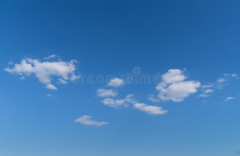 A clear Blue sky with white clouds in the summer royalty free stock images
