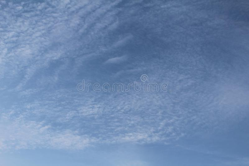 Blue sky, white clouds and sunshine royalty free stock photography
