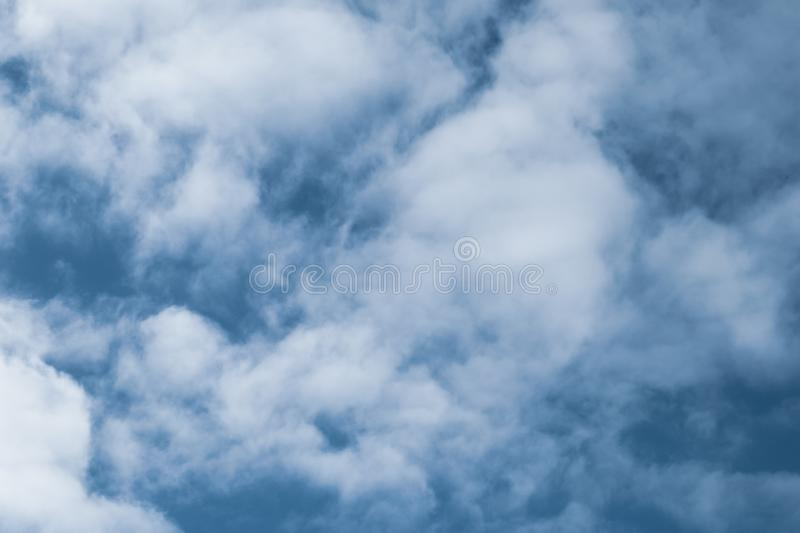 Blue sky with white clouds. Texture of cloudscape. Grey sky background with clouds. Dramatic scene royalty free stock photography