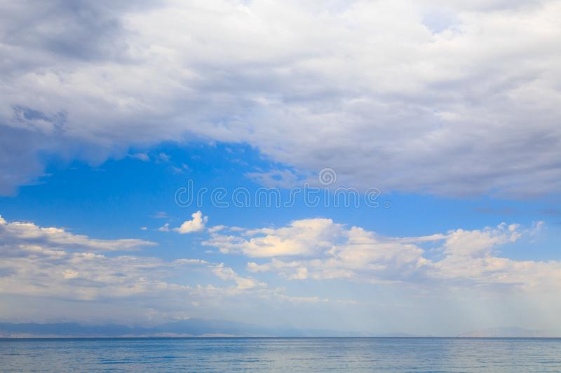 Blue sky with white cumulus clouds. Abstract natural background. Perfect summer day in the countryside stock photography