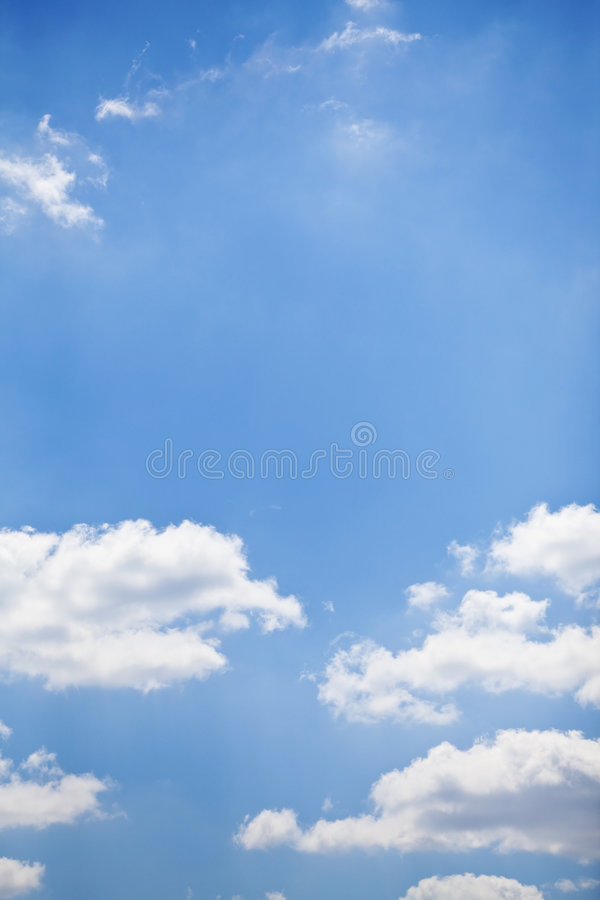 Blue sky with white fluffy clouds background royalty free stock photos