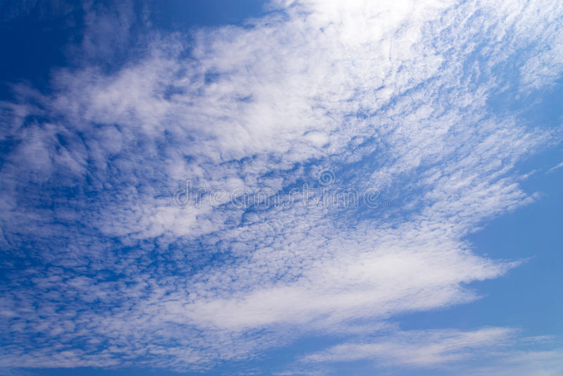 Blue sky with white fluffy tiny clouds background and pattern. Blue skys with white fluffy tiny clouds background and pattern royalty free stock images