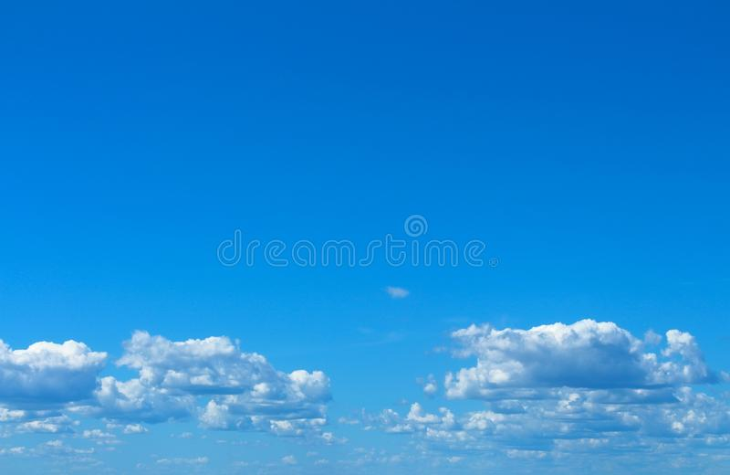 Blue sky with white light clouds background. royalty free stock images