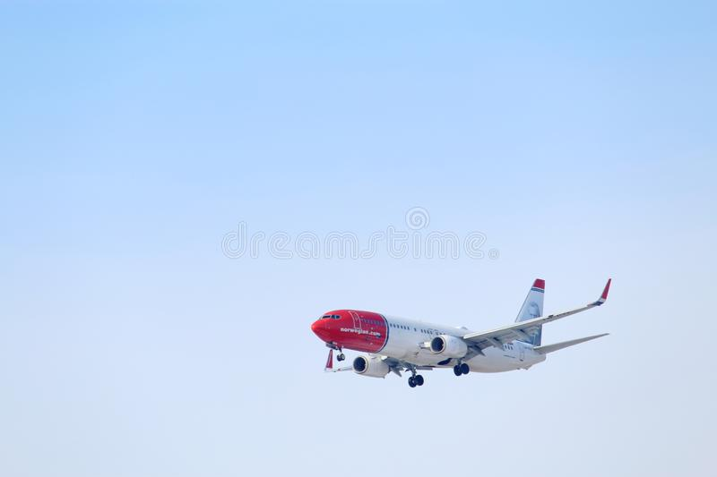 Landing plane in clear winter sky royalty free stock photos