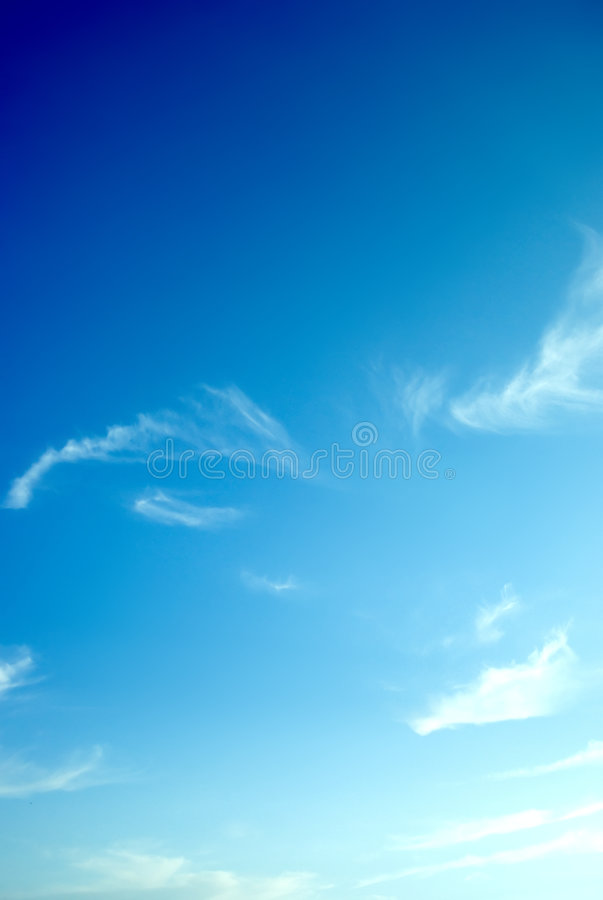 Blue sky and wispy clouds stock photos
