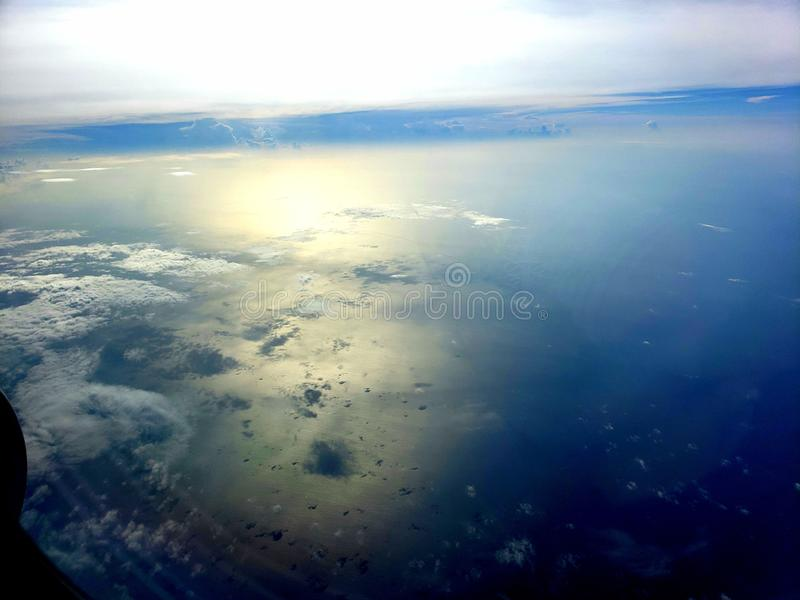 Blue skys over the Pacific ocean stock photography