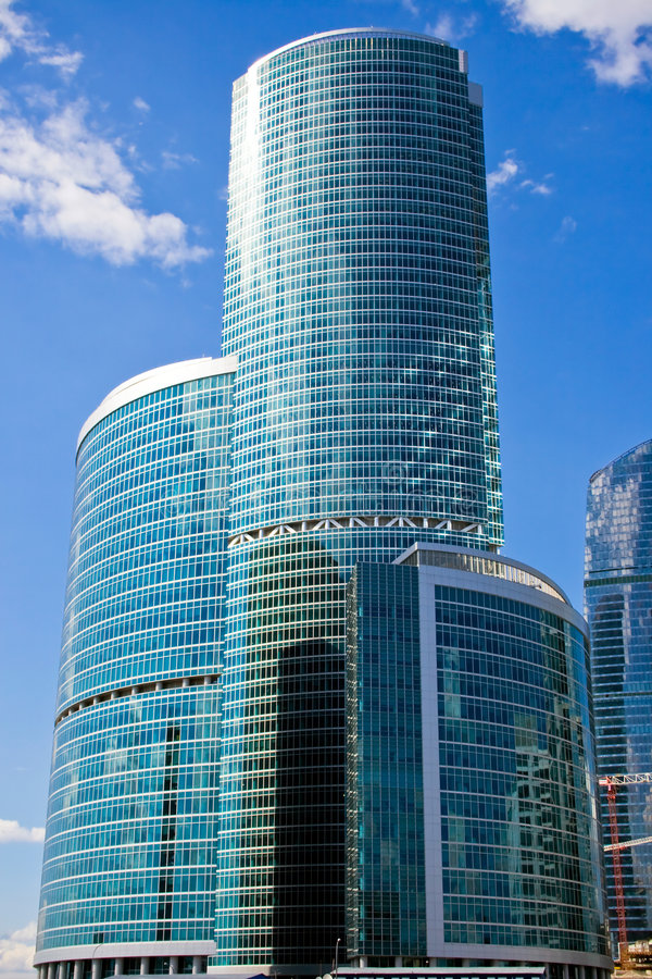 Blue skyscraper in the sky stock images