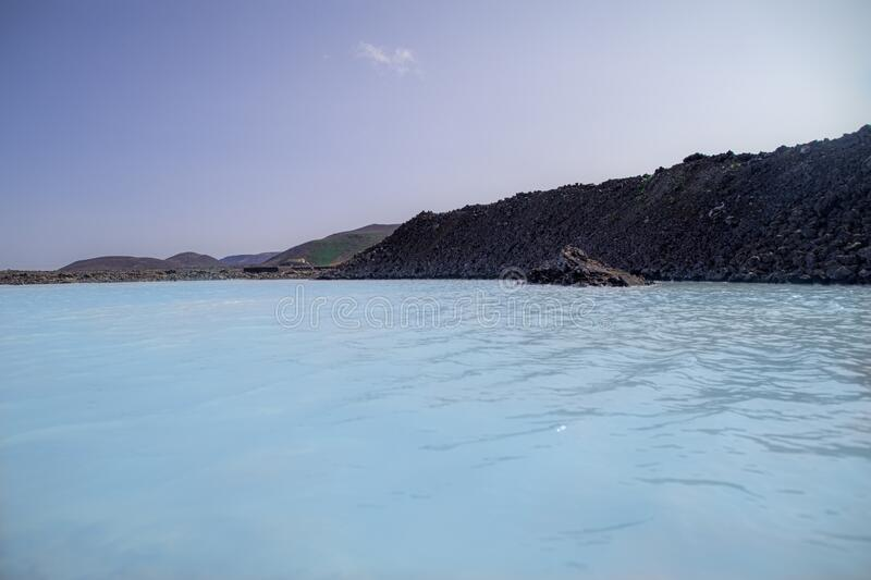 Blue sly and blue lagoon. Amazing azure waters of Blue Lagoon in Iceland. Beautiful clear skies of August royalty free stock images