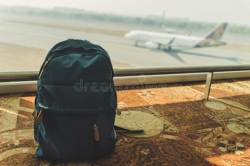 Blue small backpack standing on the floor at the airport stock images