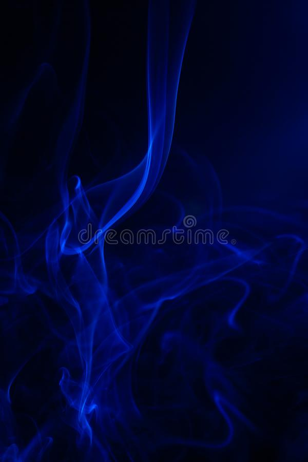 Blue smoke on black background. Abstract, air, aroma, art, burning, cigarette, color, concept, creativeness, curve, delicate, design, detail, dynamic, effect stock photo