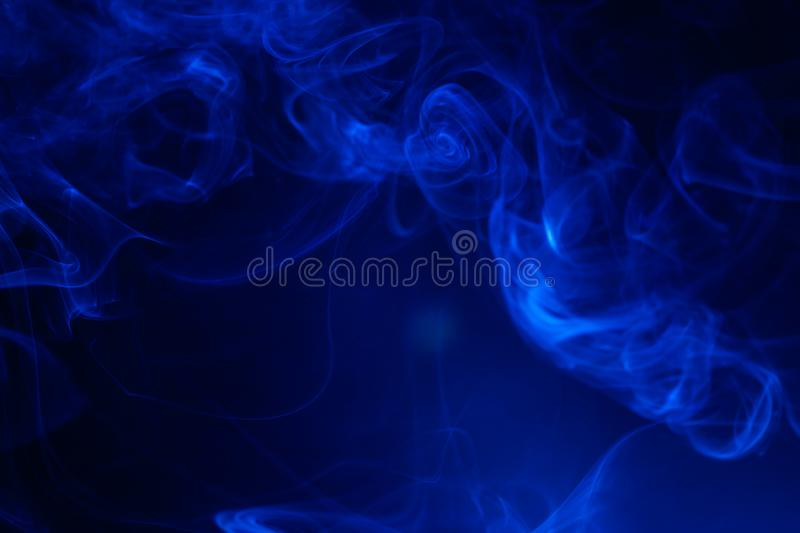 Blue smoke on black background. Abstract, air, aroma, art, burning, cigarette, color, concept, creativeness, curve, delicate, design, detail, dynamic, effect stock photography