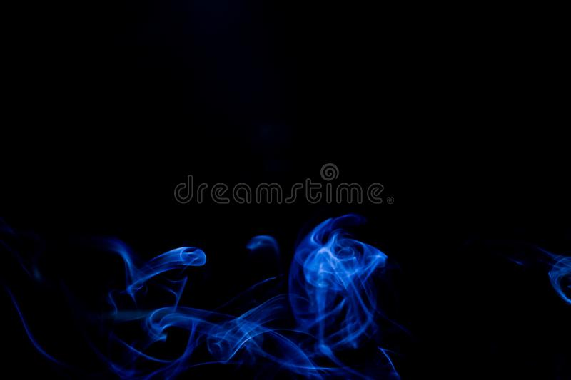 Blue smoke on black background. Abstract, air, aroma, art, burning, cigarette, color, concept, creativeness, curve, delicate, design, detail, dynamic, effect stock images