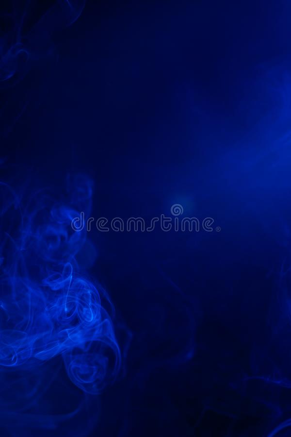 Blue smoke on black background. Abstract, air, aroma, art, burning, cigarette, color, concept, creativeness, curve, delicate, design, detail, dynamic, effect royalty free stock image