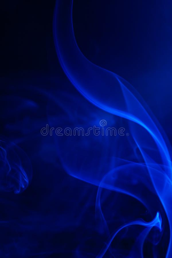 Blue smoke on black background. Abstract, air, aroma, art, burning, cigarette, color, concept, creativeness, curve, delicate, design, detail, dynamic, effect stock photos