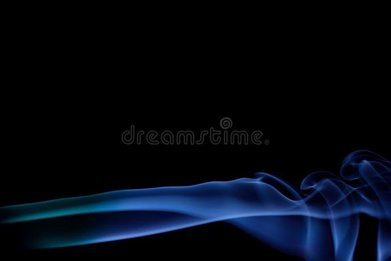 Blue smoke on a black background, abstract smoke swirls stock photo