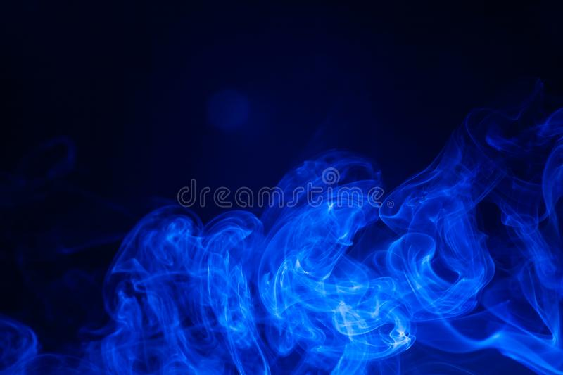 Blue smoke on black background. Abstract, air, aroma, art, burning, cigarette, color, concept, creativeness, curve, delicate, design, detail, dynamic, effect royalty free stock images