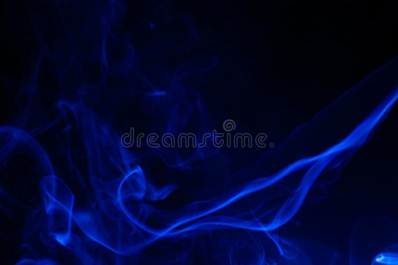 Blue smoke on black background. Abstract, air, aroma, art, burning, cigarette, color, concept, creativeness, curve, delicate, design, detail, dynamic, effect royalty free stock photos