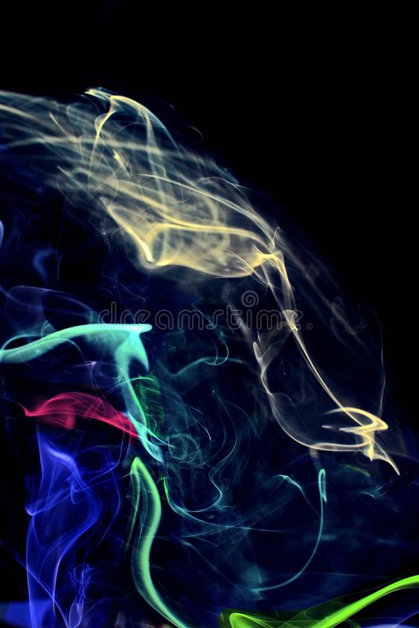 Blue smoke on black background. Movement of blue smoke. stock photography