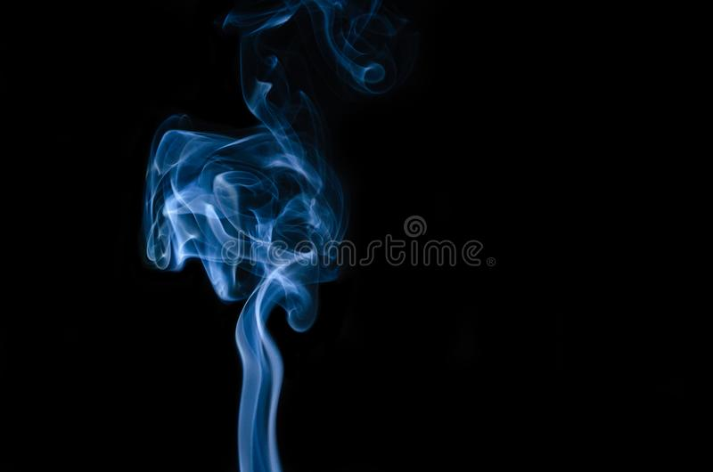 Blue smoke on black background royalty free stock photography