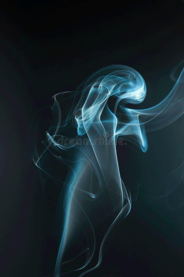 blue smoke in the dark royalty free stock photos