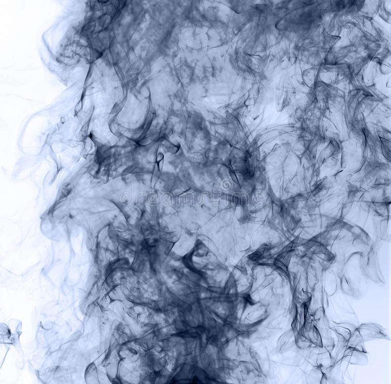 Blue smoke on a white background. inversion stock photo