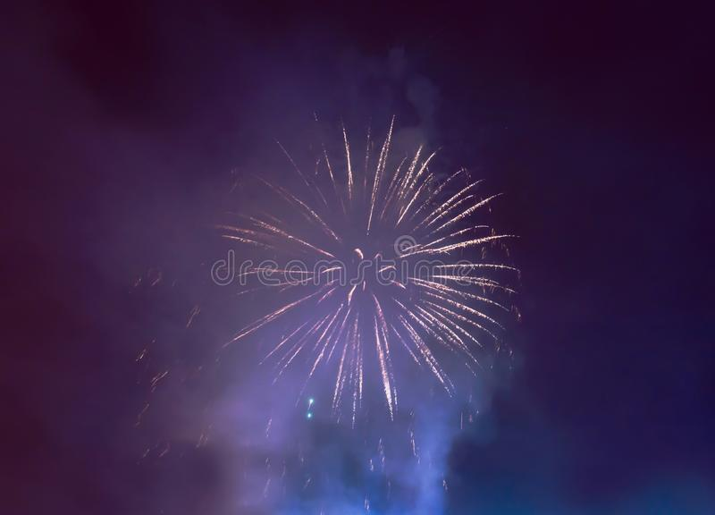 Blue smoke and white fireworks. In night sky to celebrate event royalty free stock image