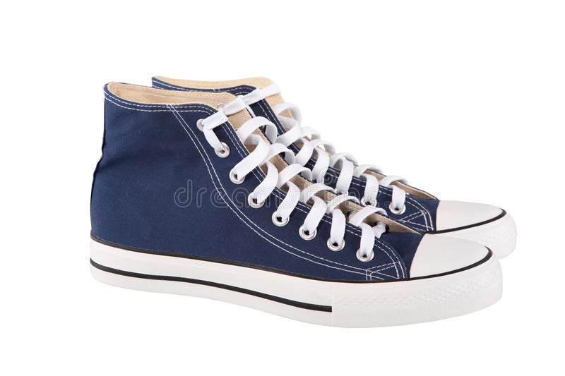 Blue sneakers. Pair of new blue sneakers on white background stock photo