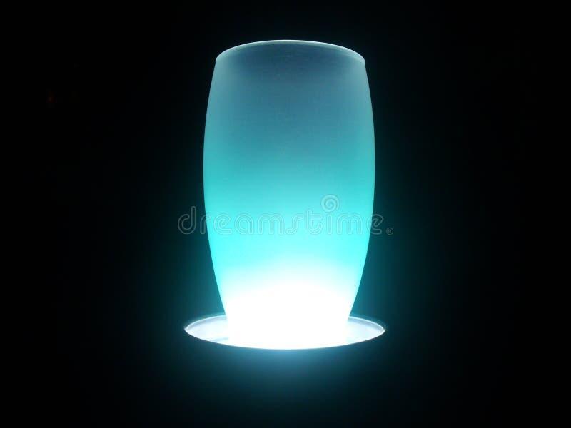 Blue snowed vase illuminated stock photography
