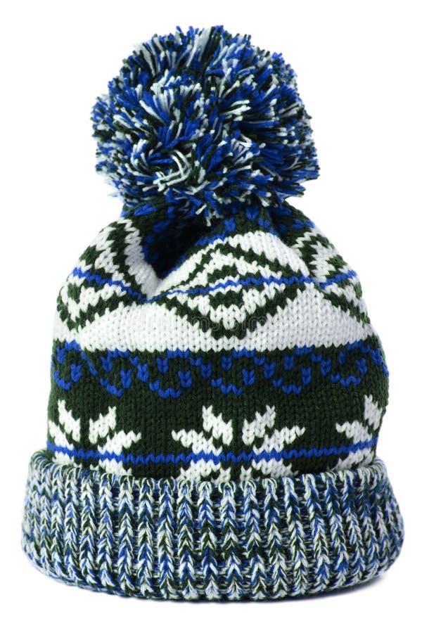 Blue snowflake pattern winter ski bobble hat isolated white royalty free stock photos