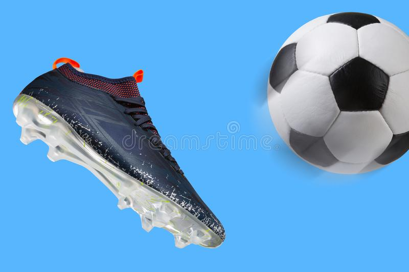 Blue soccer shoe as if kicks the ball, the ball flies, concept on a blue background stock images