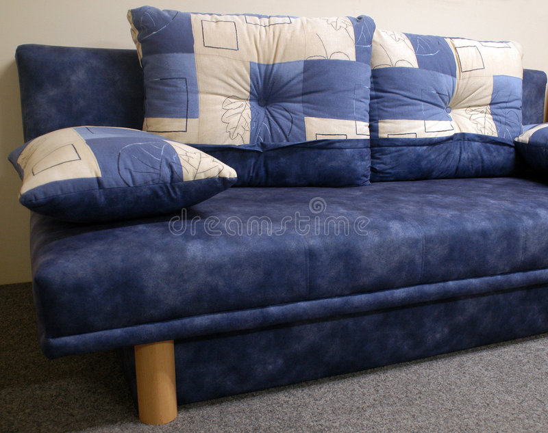 Blue sofa or couch. Details of a blue sofa or couch with matching pillows stock image