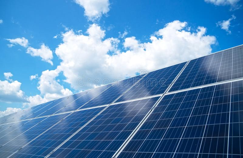 Blue solar panels. Blue solar panels over blue sky. Renewable energy royalty free stock photos