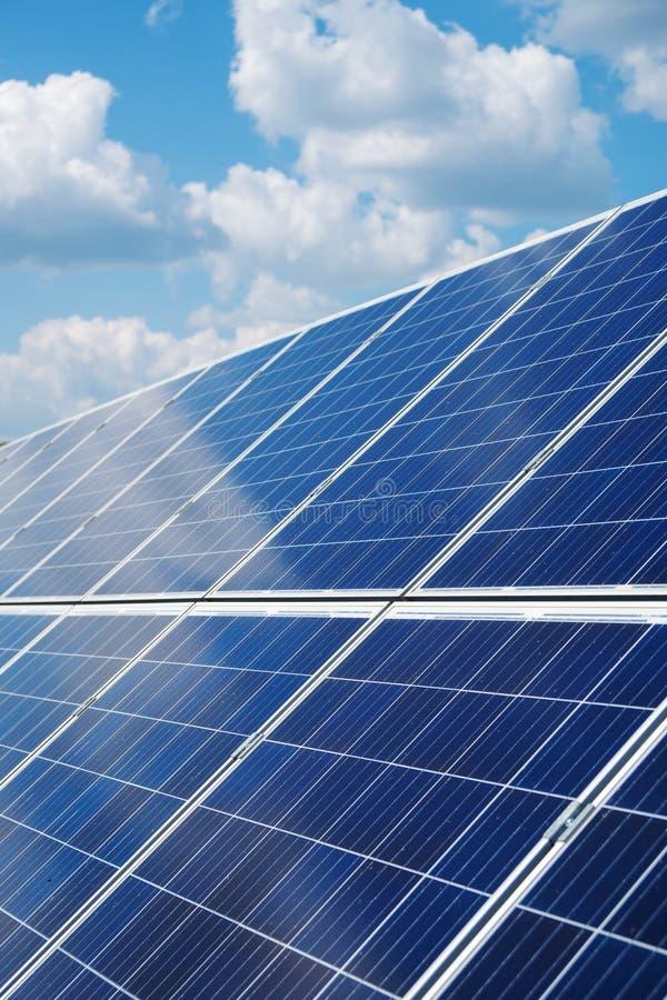 Blue solar panels. Blue solar panels over blue sky. Renewable energy stock photography