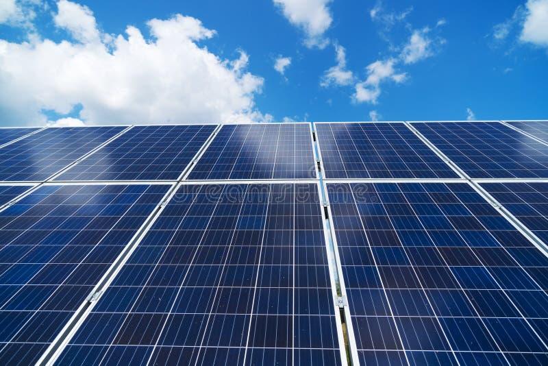 Blue solar panels. Blue solar panels over blue sky. Renewable energy stock photo