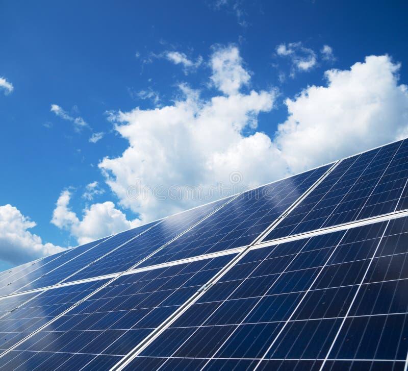 Blue solar panels. Blue solar panels over blue sky. Renewable energy royalty free stock photography