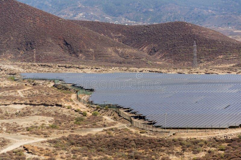 Blue solar panels at photovoltaics power station farm, future innovation energy concept, clear blue sky background. Granadilla, Tenerife stock photo