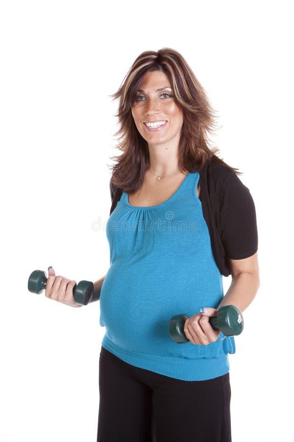 blue som lyfter gravida övre vikter arkivbilder
