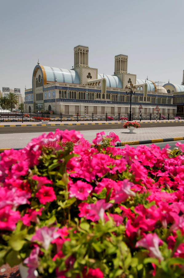 Blue souk in Sharjah. Exterior of Arabic souk in Sharjah city with flowers blooming in foreground, United Arab Emirates royalty free stock photos