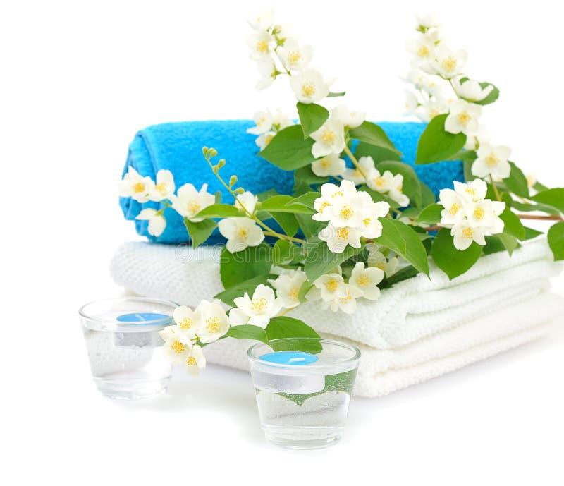 Blue spa with jasmin. On white background stock photos
