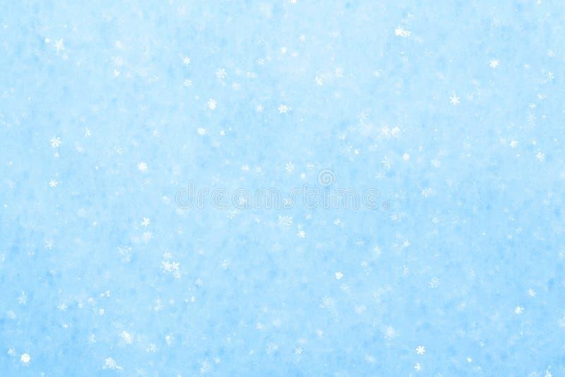 Blue sparkling snow background. stock image