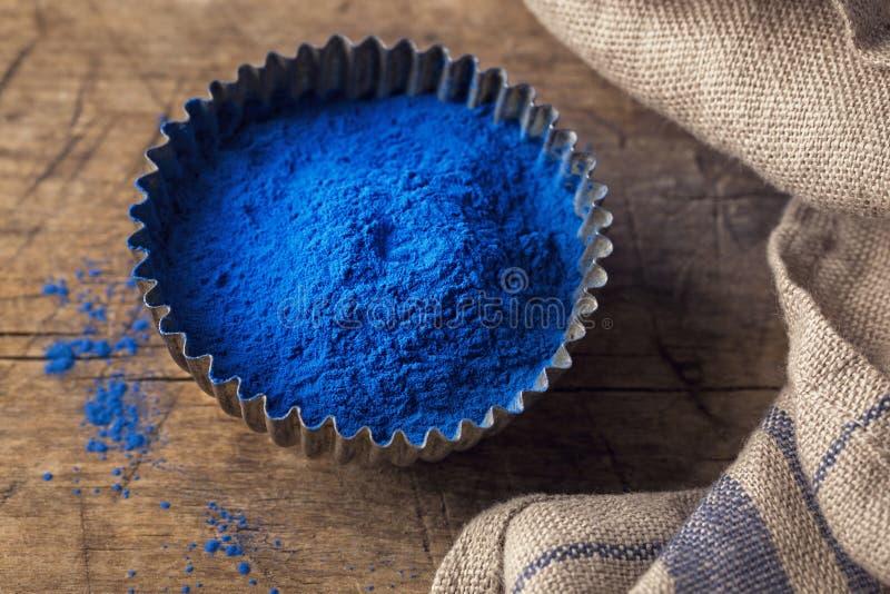 Blue spirulina powder stock images